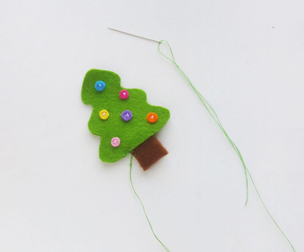 Sewing tree stump to felt Christmas ornaments