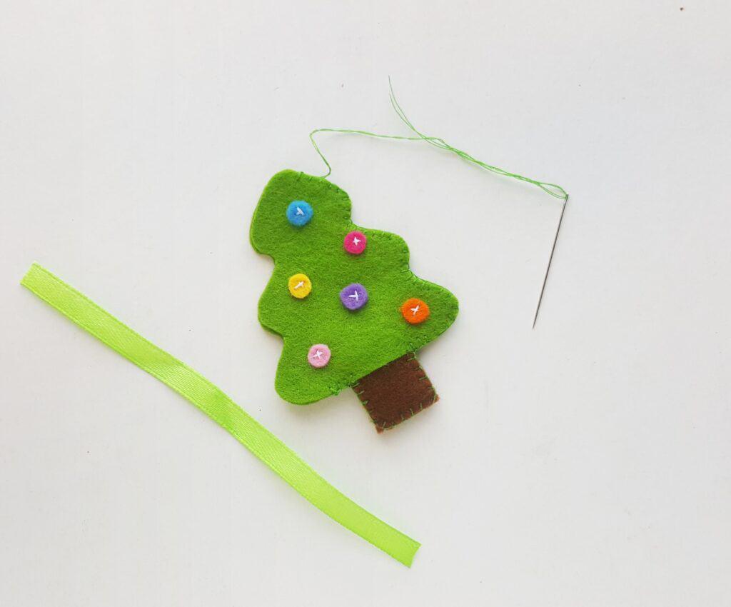 Sewing ribbon to felt Christmas ornaments