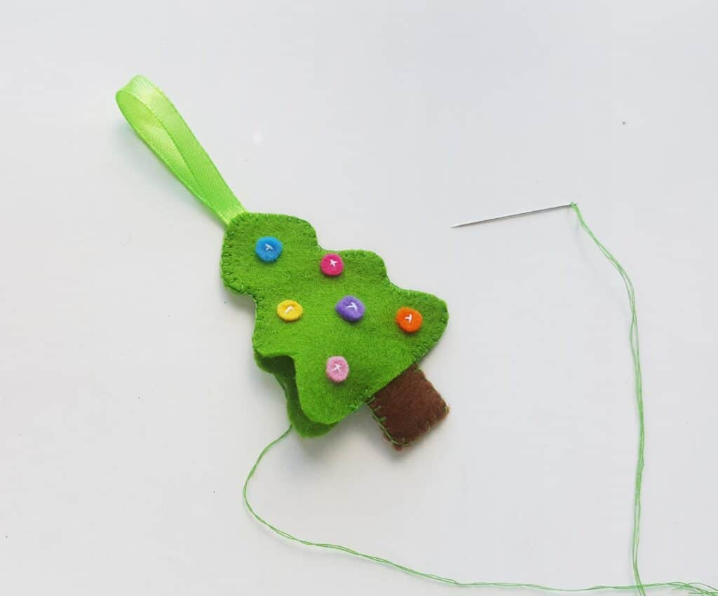 Sewing felt christmas ornaments together
