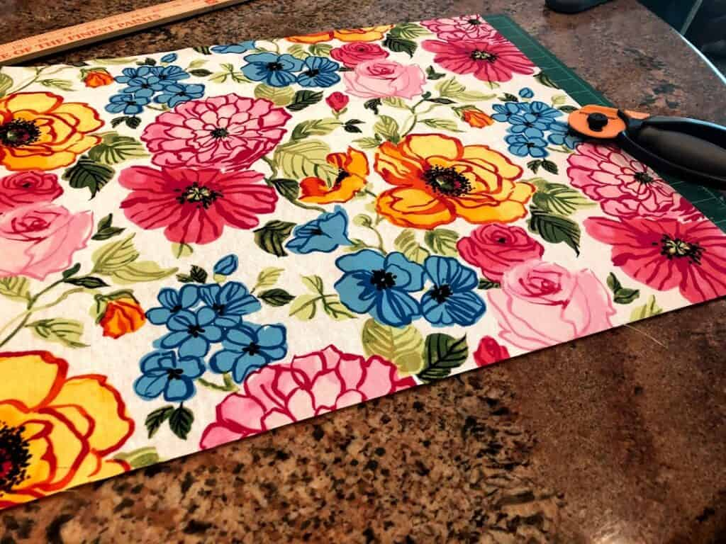 Cutting floral fabric on cutting mat