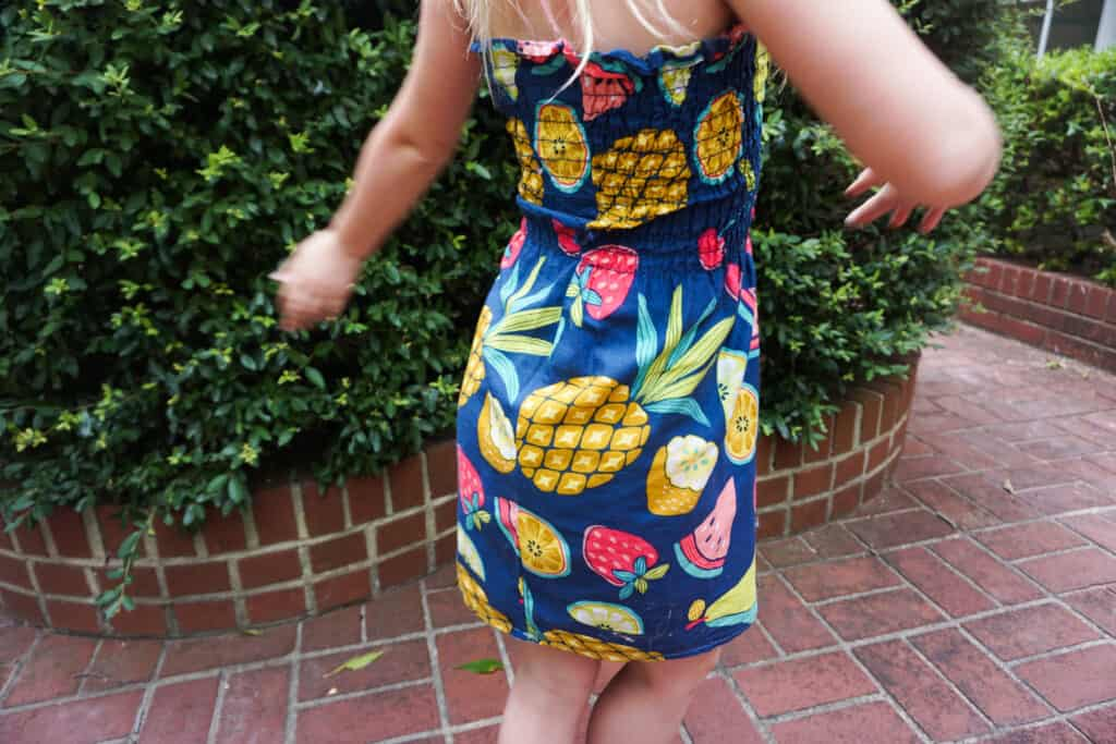 Girl modeling fruit simple shirred dress