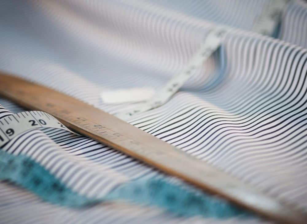 Pin striped fabric with yard stick