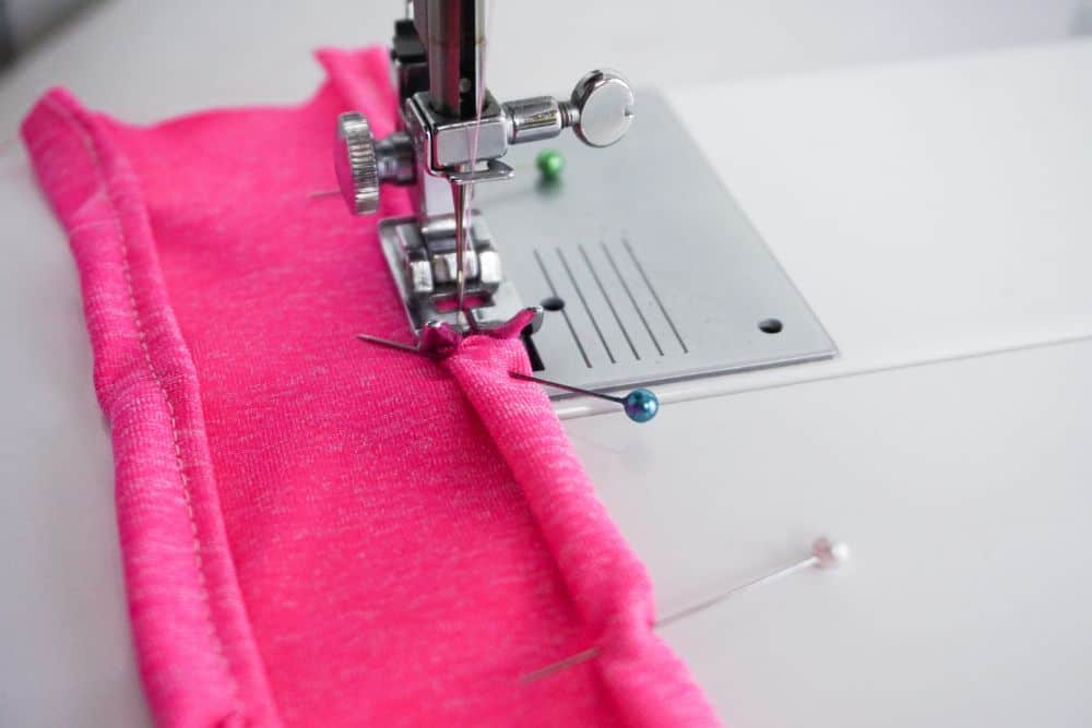 Hemming pink knit fabric with sewing machine
