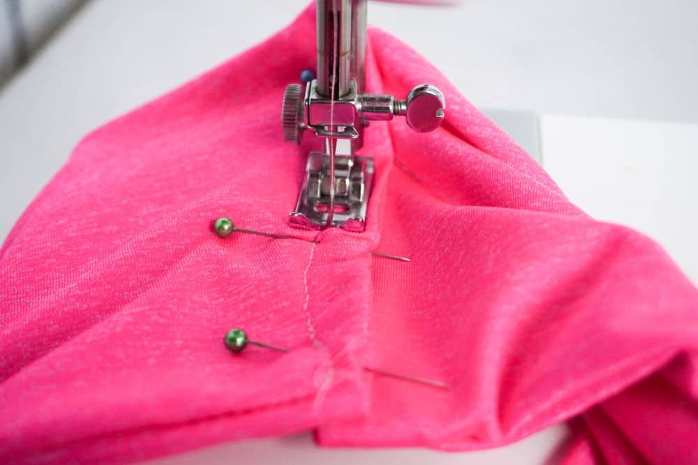 Sewing headband into loop on sewing machine