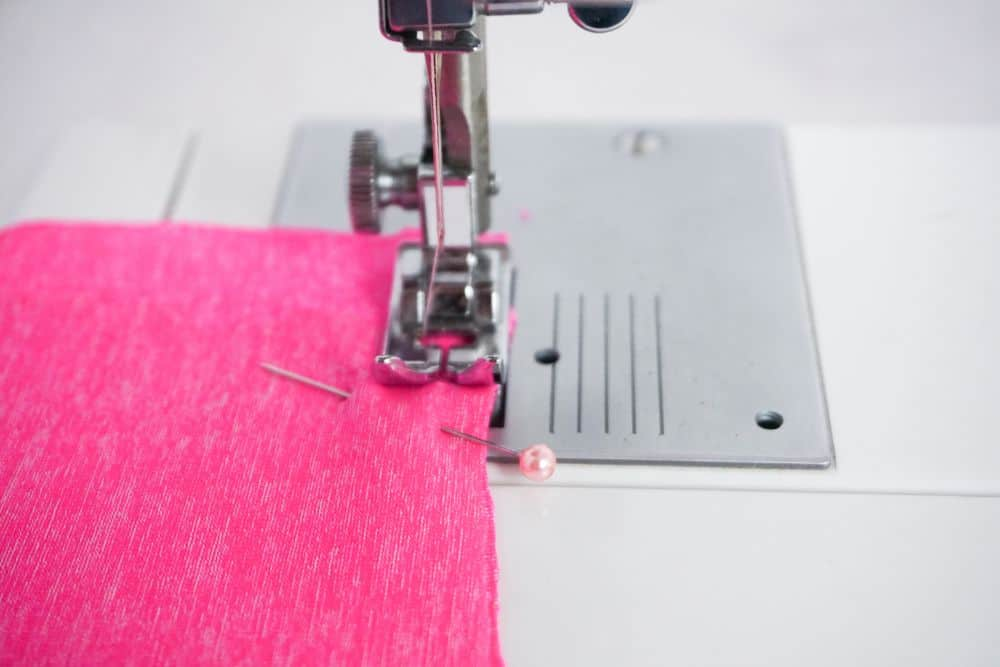 Sewing pink knit fabric on sewing machine