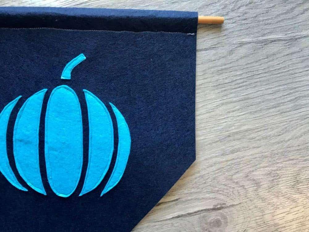 insert dowel rod into pumpkin banner