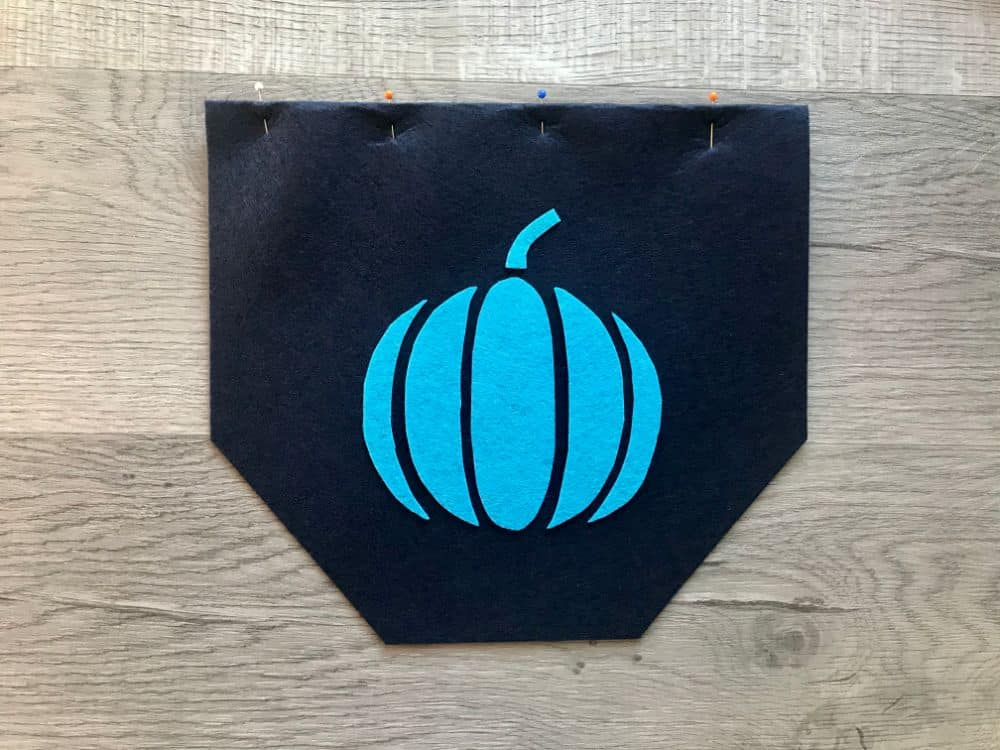 laying pumpkin pieces on background