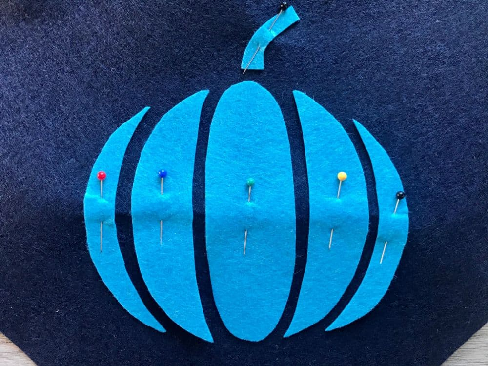pinning pumpkin pieces to background