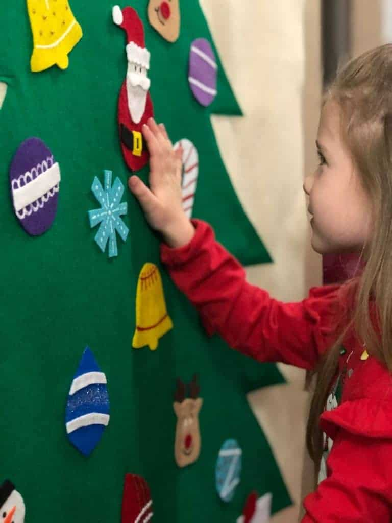 adding ornaments to tree