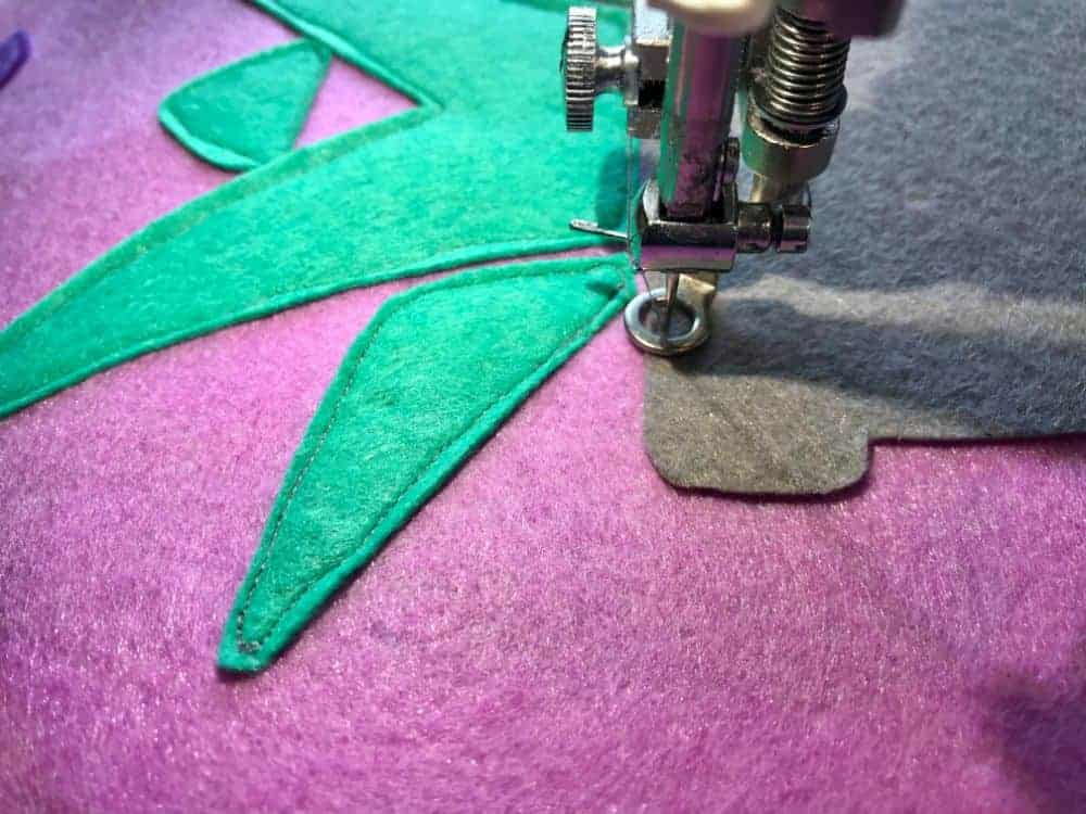 sewing on succulent to banner
