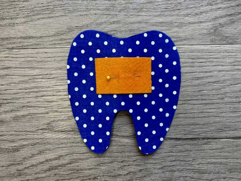 pin pocket on tooth fairy pillow front