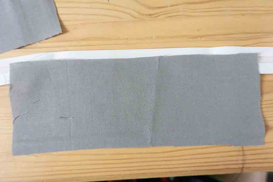 Cut and place bias tape on fabric pieces