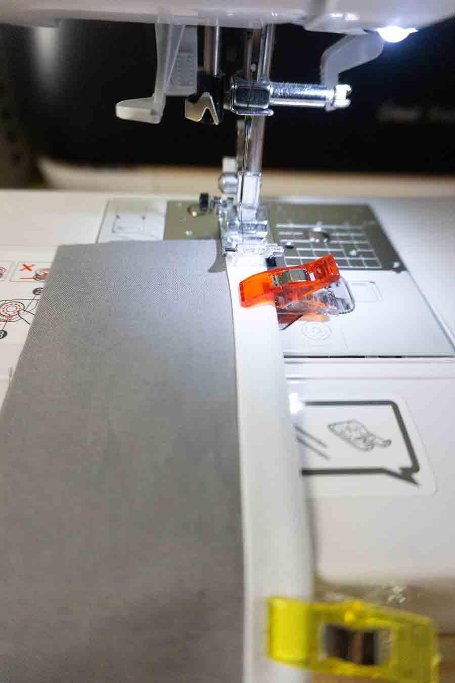 Sew bias tape to wallet pieces