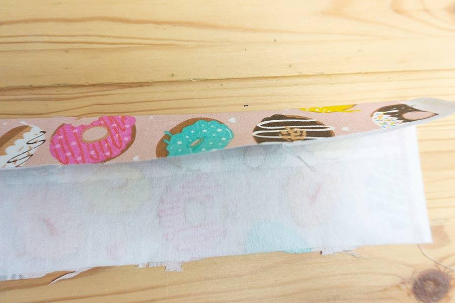 Press pellon interfacing to Wristlet key fob fabric