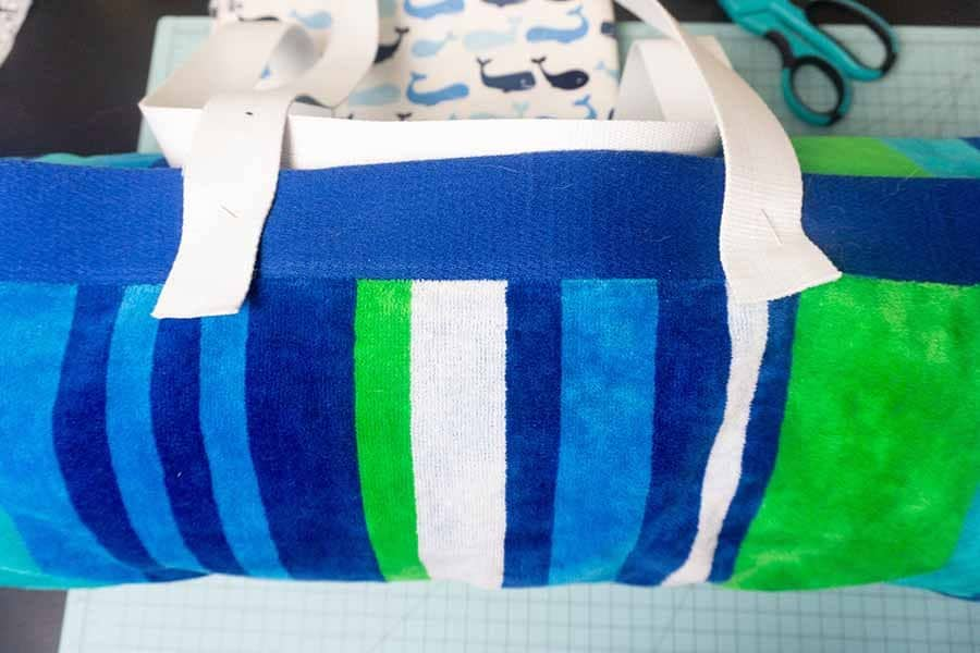 pin straps to other end of beach roll-up bag